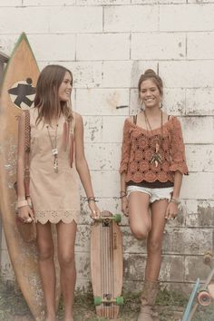 Love the girl on the right's, outfit! Orange crocheted top and shorts, with all that amazing  jewelry!!!