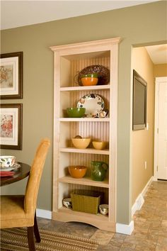 Full-height, wood curio in the kitchen. So convenient!