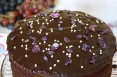 Chocolate birthday cake with violet petals