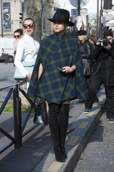 Miroslava Duma in a plaid cape and thigh-high boots  - Paris Fashion Week #StreetStyle Fall 2014 #PFW