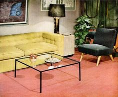 A great mid-century living room featuring a glass coffee table and yellow sofa, 1948