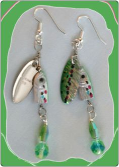 http://diginanchors.com/EarringsAlure_DangleGreenSpinner - Dangling earrings made with beautifully green and silver finished, high quality lures. Added to each fishing lure is sparkling, clear crystals,and green translucent fire-polished beads matching the color of the lure. The unique earring are 3 and 1/4 inches long .The earrings are hung on silver plated surgical stainless steel ear wires.