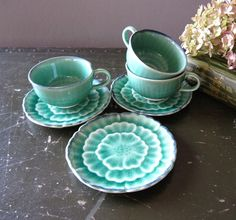 Kotobuki Japanese Tea Cups and Saucer.  Green Glaze Flower Design.