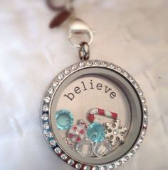Origami Owl Living Locket.... FREE CHARM WITH A $25 OR MORE PURCHASE... Contact me to place your order YourCharmingLocket@gmail.com or message me on Facebook https://www.facebook.com/YourCharmingLocket. . ---LIKE OUR FAN PAGE FOR A CHANCE TO WIN A FREE CHARM. 3 WINNERS EVERY MONTH--- Want more than just one locket, consider joining our team for an extra income.
