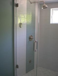 Here, The Simple Glass Tile Draws Attention To The Luxury Shower System (by Lisa Joyce Design)