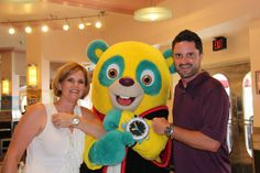 At Hollywood & Vine Restaurant in Disney World, Adrienne and Derek Bonner show off their watches along with Special Agent Oso. Adrienne is wearing a TAG Heuer Aquaracer Automatic Two-Tone, Derek is wearing a TAG Heuer Aquaracer Day-Date Automatic Chronograph, and Special Agent Oso has a cool watch of his own.