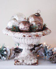 Glass ornaments in a vintage urn