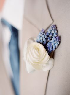 White and blue boutonniere we adore!