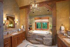 love the stone steps to the tub, and the wood frame!!!