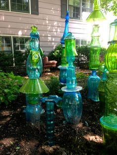 JuxtaposeJane's Glass Totem Garden: note the blue glass avon car in the foreground... craft, garden totem, glass car, blue glass, garden art, glass totem, juxtaposejan glass, blues, totem garden