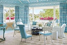 Miles Redd ~ LIVING ROOM The living room walls and ceiling are covered in a China Seas fabric, with curtains to match