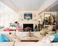 Living Room Photo - Neutral furniture with pops of pink, blue, and leopard in a living space
