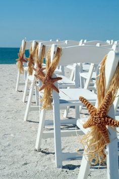 Starfish on the chairs at a beach wedding, so cute!