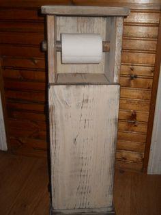 Primitive Rustic Farmhouse Bathroom Toilet Paper Holder. $44.99, via Etsy.