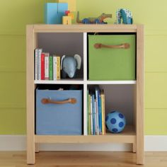 storage boxes and books in cubes for the beds in girls room