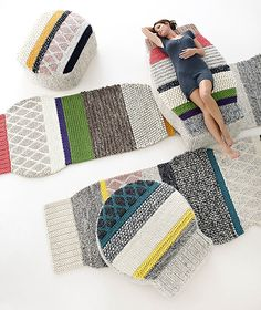 Mangas rugs and poufs (Mangas means sleeves in Spanish) by Patricia Urquiola