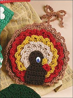 """Turkey Towel Topper - This towel topper combines crochet and plastic canvas into a darling turkey towel topper that measures 7"""" across.  Skill Level: Easy  Designed by Maggie Weldon  free pdf from freepatterns.com"""