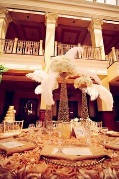 Tall white feather and floral centerpieces #wedding #gatsby #tablescape #centerpiece #gold