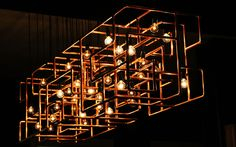 restaurant light fixture. copper pipes.