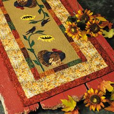 A great thanksgiving quilt project - an applique turkey takes a rest beneath a sunflower. From the book: http://landauerpub.com/Granola-Girl-Designs-Nature-s-Table-Toppers.html