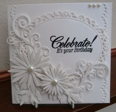 All white card, floral ovals and delicate aster dies.