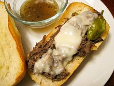 Italian Drip Beef -    ■1 whole Beef Chuck Roast, 2.5 To 4 Pounds  ■1 can Beef Consomme Or Beef Broth  ■3 Tablespoons (heaping) Italian Seasoning  ■1 teaspoon Salt  ■1/4 cup Water  ■1/2 jar (16 Oz) Pepperoncini Peppers, With Juice  ■Buttered, Toasted Deli Rolls