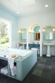 I love ice blue and white bathrooms.