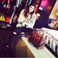 Kourtney Kardashian wins at Instagram by posing with her Givenchy handbag and cute cat. www.handbag.com