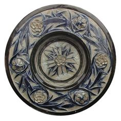 "Martin Brothers Pottery - Walter Fraser Martin (1857-1912) - Floral Decorated Charger. Incised, Painted & Glazed Stoneware. Southall, Middlesex, England. Circa 1875. 12"" x 2""."