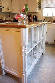 Old vintage windows on a kitchen island. Love the way it turned out.