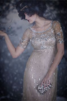 Love the beaded, 1920's effect of this romantic wedding dress. Sequined wedding dress from BHLDN.