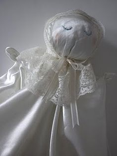 Fabric doll - stuffed head, fabric body and embroidered face. Start making these as new baby gifts?