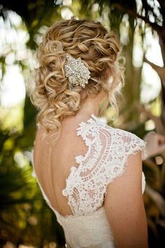 Beautiful and curly. Romantic, shows off the dress, functional. Great bridal hair look!