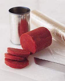 Tomato Paste Saver: Most recipes call for only a small portion of tomato paste -- you use a tablespoon or two, and the rest invariably goes to waste. To save the remainder: Carefully open both ends of the can with a can opener. Remove one metal end, and discard it. Leave the other in place. Wrap the entire can in plastic wrap, and freeze overnight. The next day, use the metal end to push the frozen paste out the open end. Discard can, tightly rewrap unused portion, and store in freezer up to 3 months, slicing off just as much as you need each time you cook. (found here: www.marthastewart...)