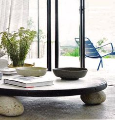 Low coffee table w/ natural stone   Like the smooth stones! :-)