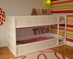 IKEA Hackers: Girly Kura bunk bed.  This would free up some space in the girls' room