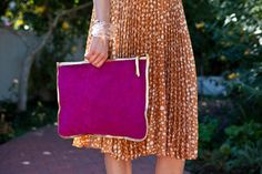 Oversized suede clutch...it would probably hold a few diapers!!!