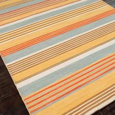 Handcrafted wool flatweave rug with multicolor striping.   Product: RugConstruction Material: 100% WoolColor: Yellow and multiFeatures:  ReversibleDurableEasy care Note: Please be aware that actual colors may vary from those shown on your screen. Accent rugs may also not show the entire pattern that the corresponding area rugs have.Cleaning and Care: Vacuum regularly. Blot spills immediately with mild soap and cold water to prevent shrinkage