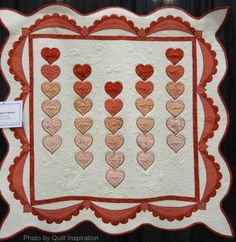 A Cascade of Hearts by Joelyn Fevurly (Leavenworth, Kansas), quilted by Theresa Ward,  shown at AQS Phoenix - 2014.  Photo by Quilt Inspiration
