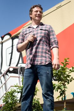 Chef Jamie Oliver addresses the crowd during Food Revolution Day at UCLA