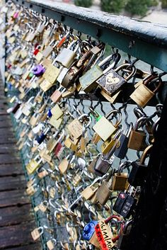 Les Ponts Des Arts, Paris  The bridge where lovers use a lock to lock their love in.   so so sweet.