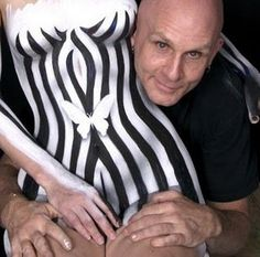 Here is Craig Tracy with one of his beautiful body art models.