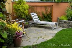 flagstones with moss & wood frame metal trellis