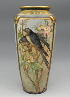 Tall Art Nouveau Limoges Vase with Bird Painting, Marked underneath in green is the Tressemann & Vogt logo, Limoges, and France.