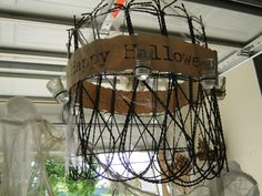 Bachman's Idea House Minneapolis, MN. Halloween Chandelier Old wire fence and insulators