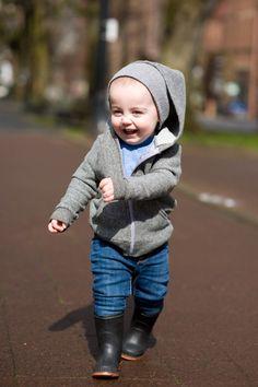 happy gray hooded girl