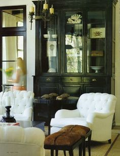 black antique hutch white tufted chairs