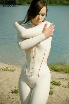 Lucious lipped model in a white bodysuit and corset Pretty