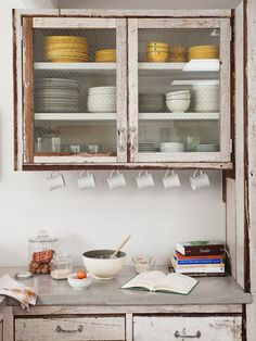 Line upper cabinets with chicken wire to hang coffee mugs. #storage