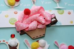 Sculpture Clippies Pink Cupcake Bow. Pink or White Cupcake Sculpture Ribbon Clip. Free Ship Promo. $4.00, via Etsy.